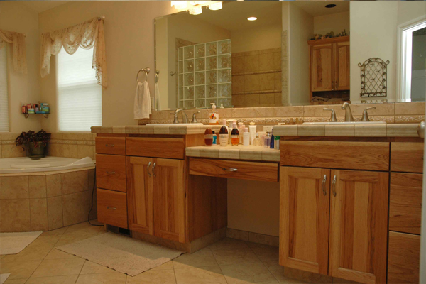 Dual sink vanity by Amcraft Custom Cabinetry & Countertops