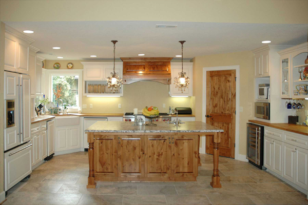 Rustic Farmhouse Kitchen by Amcraft Custom Cabinetry & Countertops