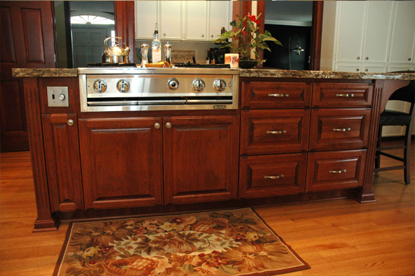 Kitchen Island with Stove by Amcraft Custom Cabinetry & Countertops
